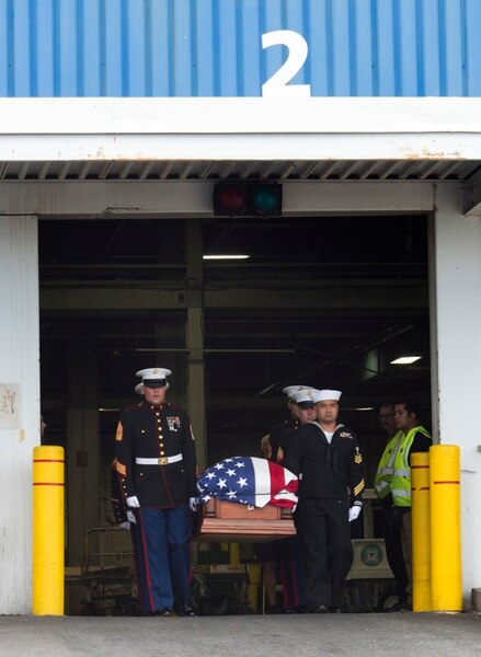 (Rick Egan   The Salt Lake Tribune) The remains of Marine Pfc. Robert K. Holmes are carried from the Delta Air Cargo to a hearse for transportation to the mortuary. Holmes died aboard the USS Oklahoma during the attack on Pearl Harbor. Friday, Aug. 17, 2018.