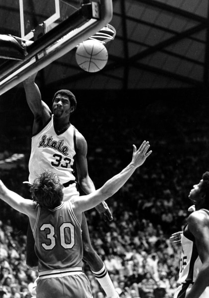 (AP Photo) Earvin Magic Johnson of Michigan State slams one home as he collides with Indiana State's Bob Heaton during their NCAA championship game in Salt Lake City on March 27, 1979.