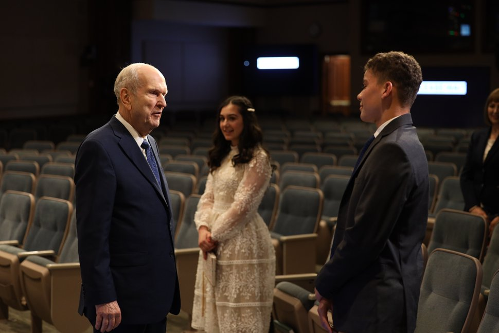 (photo courtesy The Church of Jesus Christ of Latter-day Saints) President Russell M. Nelson speaks with Laudy R. Kaouk, center, and Enzo S. Petelo during the Saturday evening session of General Conference on April 4. 2020. The two young people spoke during the session.