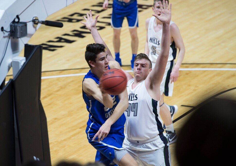 Scott Sommerdorf | The Salt Lake Tribune Pleasant Grove's Matthew Van Komen passes past Copper Hills' Trevon Allfrey during first half play. Pleasant Grove defeated Copper Hills 57-42, in a boy's 6A semi-final, FrIday, March. 2, 2018.