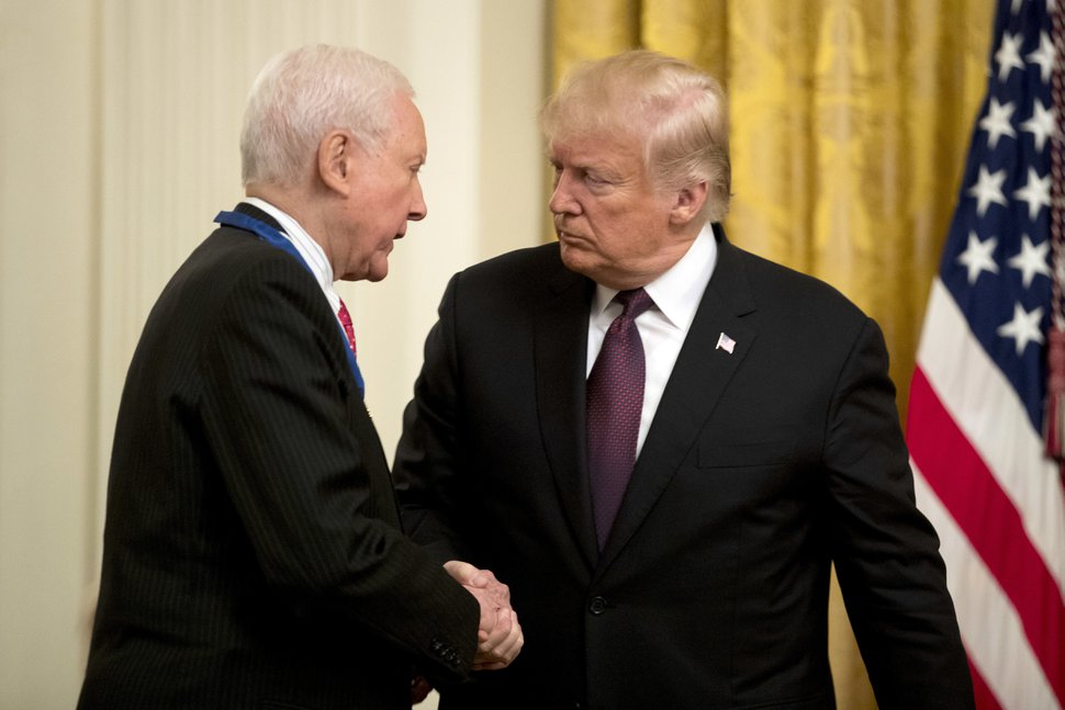 President Donald Trump shakes hands as he awards Sen. Orrin Hatch, R-Utah, the Medal of Freedom during a ceremony in the East Room of the White House in Washington, Friday, Nov. 16, 2018. (AP Photo/Andrew Harnik)