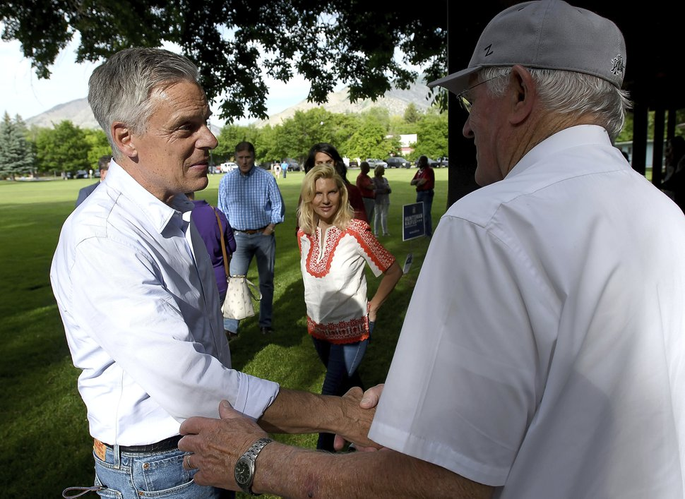 Utah gubernatorial candidate Jon Huntsman Jr., left, shakes hands with people during a campaign stop Thursday, June 4, 2020, in Logan, Utah. (Eli Lucero/Herald Journal via AP)