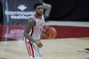 (John Locher | AP) After one season at UNLV, David Jenkins Jr. has transferred to Utah to join forces with longtime foe Craig Smith.