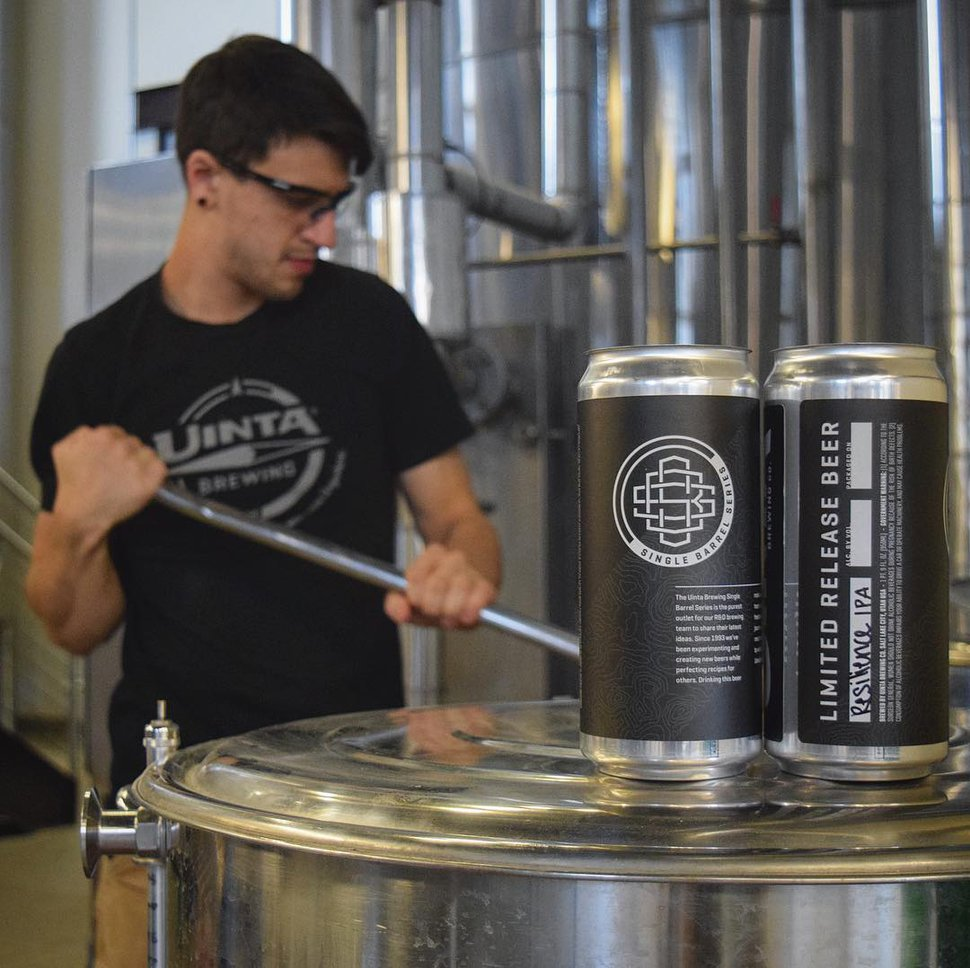 (Courtesy photo) Patrick Keahey, the research and development manager at Uinta Brewing Company, works on a batch of Resilience IPA. The beer will be available on Dec. 21 in 32-ounce crowlers, shown in the foreground.