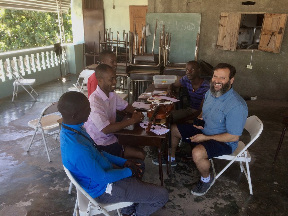 Jules Youdley   Courtesy Salt Lake City luthier John Paul Lucas works with students in Jacmel, Haiti, during a weeklong teaching trip by Utah Symphony musicians.