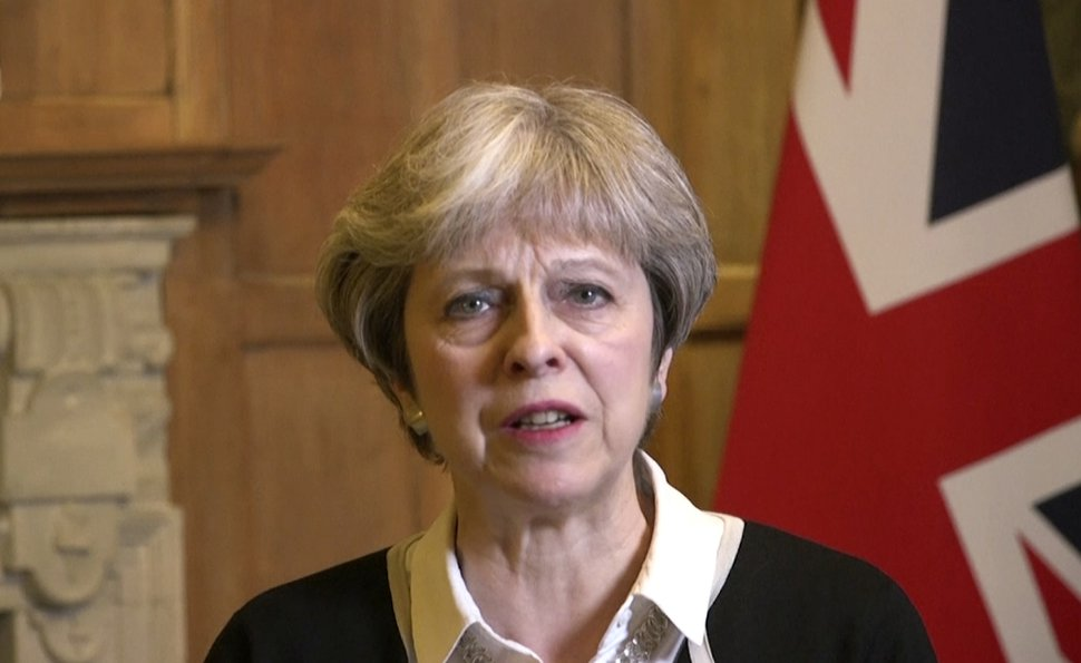 (UK Government via AP Video) In this image made from video provided by UK Government via AP Video, British Prime Minister Theresa May speaks in London, Saturday, April 14, 2018. In a message Prime Minister May announced early on Saturday morning that she has authorised British armed forces to