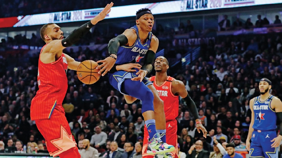 Russell Westbrook of the Houston Rockets passes around Utah Jazz center Rudy Gobert during the first half of the NBA All-Star basketball game Sunday, Feb. 16, 2020, in Chicago. (AP Photo/Nam Huh)
