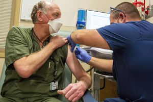 (Rick Egan | The Salt Lake Tribune)Emergency physician Bart Johansen, gets a covid-19 vaccine from Brandon Widdison, as Lehi's Mountain Point Medical Center gives out its first COVID-19 vaccines on Thursday, Dec. 17, 2020.