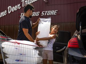 (Tailyr Irvine  The New York Times) Troy Haugen and his daughter, Ahmara, load ice into their car as temperatures reached 106 degrees in Lame Deer on the Northern Cheyenne Reservation in Montana, on July 18, 2021. The period from June through August this year was the hottest on record in the United States, exceeding even the Dust Bowl summer of 1936, the National Oceanic and Atmospheric Administration said on Thursday, September 9.