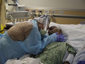 (Jae C. Hong | AP file photo) Romelia Navarro, 64, weeps on July 31, 2020, while hugging her husband, Antonio, in his final moments in a COVID-19 unit at St. Jude Medical Center in Fullerton, Calif. The U.S. death toll from COVID-19 has topped 500,000 — a number so staggering that a top health researchers says it is hard to imagine an American who hasn't lost a relative or doesn't know someone who died.