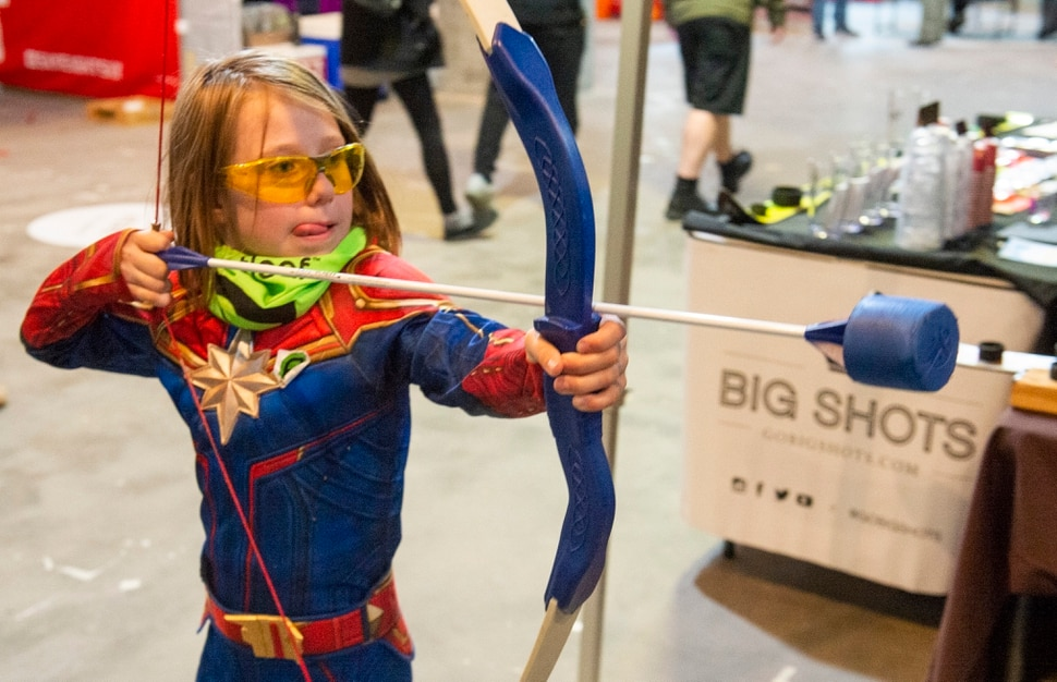 "(Rick Egan | The Salt Lake Tribune) Maddie Schulz, 7 shoots an arrow at the S.A.F.E. Archery booth at the ""Rendezvous"" Mountain Culture Festival at the Gateway, Saturday, Sept. 28, 2019."