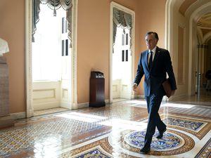 (Stefani Reynolds | The New York Times) Sen. Mitt Romney, R-Utah, walks through the Capitol in Washington on Wednesday, May 19, 2021.