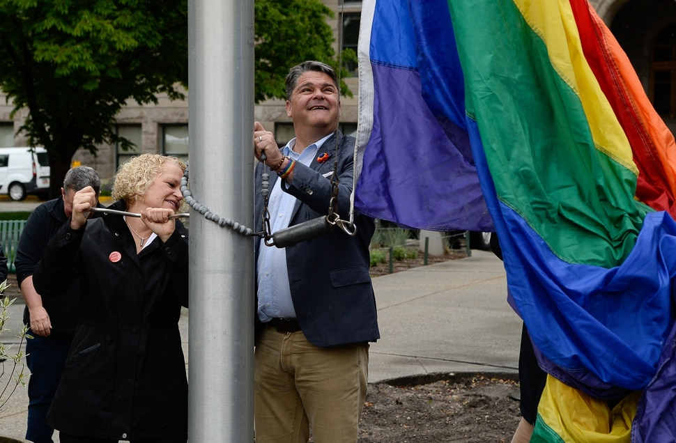(Francisco Kjolseth | The Salt Lake Tribune) Mayor Jackie Biskupski takes a turn raising the Pride flag alongside Rob Moolman, Executive Director of the Utah Pride Center as they gather at the Salt Lake City and County Building on Tuesday, May 28, 2019, for the annual Pride flag raising and Pride Week proclamation.