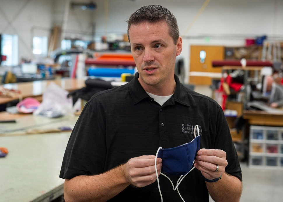 (Rick Egan   The Salt Lake Tribune) Mike Peterson, president of SugarHouse Industries explains how they are using their industrial cutting and sewing machines to make face masks and face shields, to protect against coronavirus, Thursday, March 26, 2020.