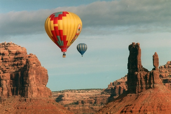 Al Hartmann | The Salt Lake Tribune Hot air balloons hover over formation in Valley of the Gods an area between Bluff and Mexican Hat. The area is included in a proposed Bears Ears National Monument.