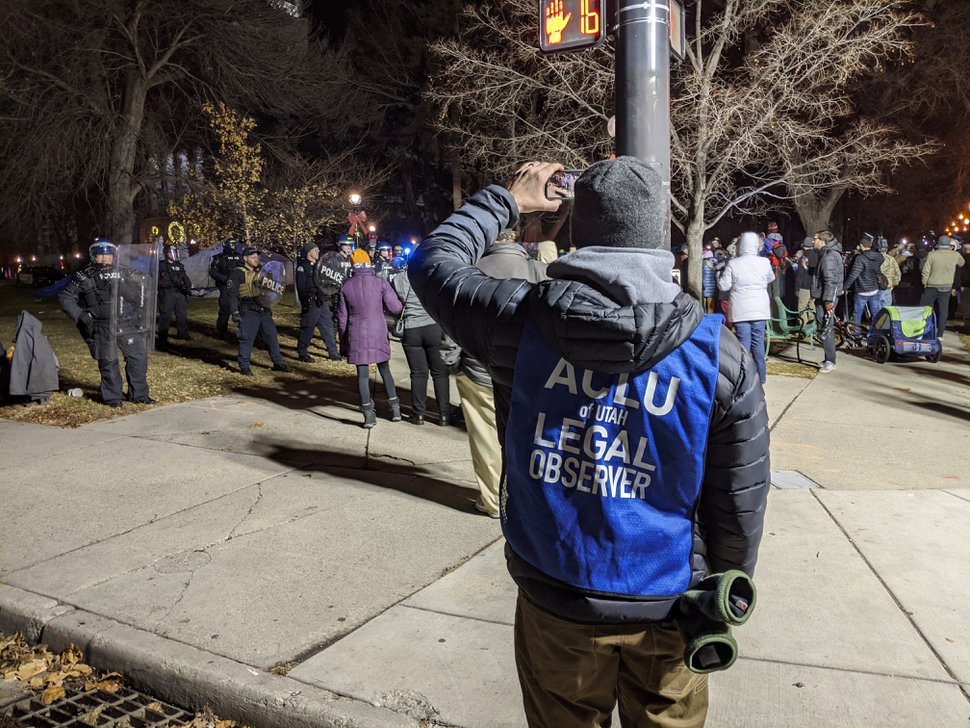 (Paighten Harkins | The Salt Lake Tribune) An ACLU legal observer documents as Salt Lake City police move in to disperse a group of protesters occupying Washington Square Park on Sunday, Jan. 5, 2020. Sixteen people were arrested.