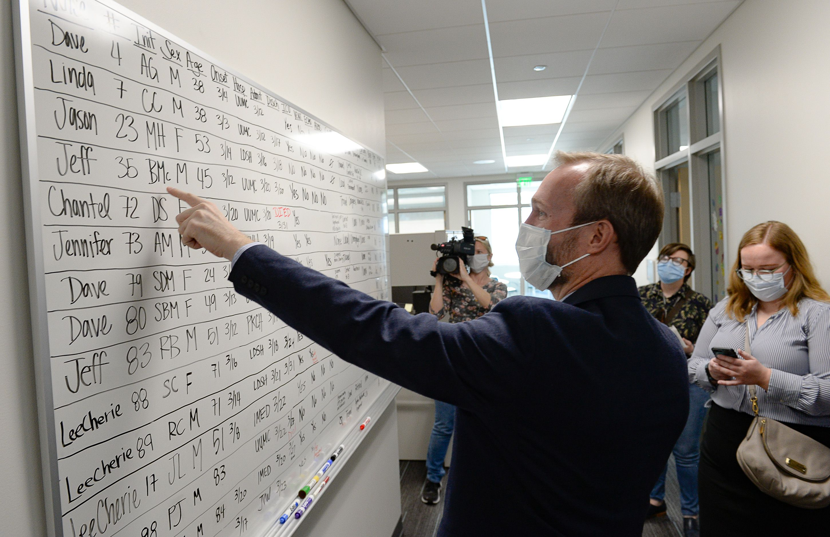 (Francisco Kjolseth     The Salt Lake Tribune) Congressman Ben McAdams, D-Utah, finds his name on a white board where Salt Lake County staff listed and tracked the earliest cases of COVID-19, as he visits the Salt Lake County Public Health Center on Tuesday, April 28, 2020. Six white boards were filled before opting to track cases on spreadsheets as the numbers continue to grow.