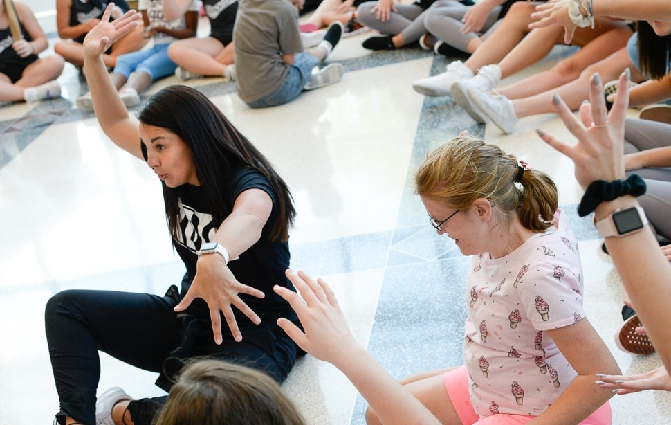 (Francisco Kjolseth | The Salt Lake Tribune) Dance Company Director Brynn Perkins warms up the students for Kauri Sue Hamilton School with different animal dance moves as Riverton High cheer, drill and dance company members team up with special needs students on Tuesday, Sept. 4, 2018, for their final rehearsal before an upcoming half-time performance on Friday when the Riverton High football team hosts Pleasant Grove.