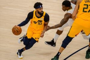 (Trent Nelson     The Salt Lake Tribune) Utah Jazz guard Mike Conley (10) defended by New Orleans Pelicans guard Eric Bledsoe (5) as the Utah Jazz host the New Orleans Pelicans, NBA basketball in Salt Lake City on Tuesday, Jan. 19, 2021.