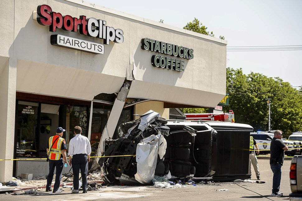 (Trent Nelson | The Salt Lake Tribune ) Authorities work at the scene where a truck drove into a Starbucks parking lot and on to an outdoor patio, Friday June 8, 2018, at a shopping center in Millcreek, Utah.