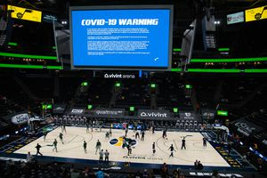 (Francisco Kjolseth  | The Salt Lake Tribune) COVID-19 warnings are display on the screen before the start of the Utah Jazz game against the Milwaukee Bucks at Vivint Smart Home Arena in Salt Lake City, on Friday, Feb. 12, 2021. The Jazz have announced that COVID-19 protocols, including face masks, will continue for guests after Utah's statewide mask mandate ends on Saturday, April 10, 2021.