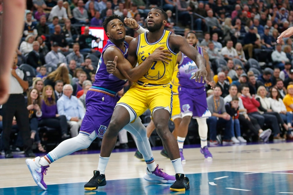 Utah Jazz guard Donovan Mitchell, left, guards Golden State Warriors forward Eric Paschall (7) in the first half during an NBA basketball game Friday, Nov. 22, 2019, in Salt Lake City. (AP Photo/Rick Bowmer)