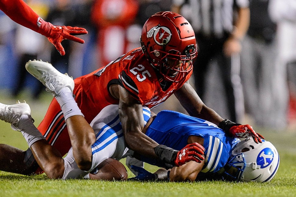 (Trent Nelson | The Salt Lake Tribune) Utah Utes defensive back Casey Hughes (25) pushes Brigham Young Cougars running back Trey Dye (4) into the ground as BYU hosts Utah, NCAA football in Provo, Saturday September 9, 2017.