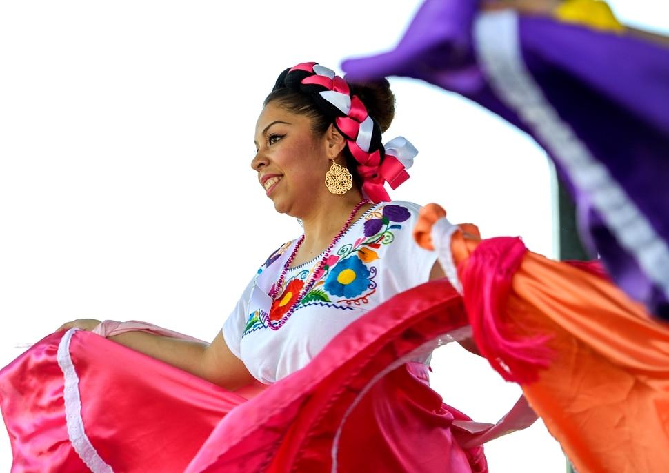 (Leah Hogsten | The Salt Lake Tribune) Tuttilli Ballet Folklorico dancer Yesenia Rivas performs at the Cinco de Mayo Celebration, Saturday, May 5, 2018 at Centennial Park in West Valley City.