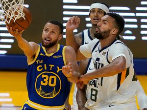 Golden State Warriors guard Stephen Curry (30) shoots against Utah Jazz center Rudy Gobert during the second half of an NBA basketball game in San Francisco, Monday, May 10, 2021. (AP Photo/Jeff Chiu)