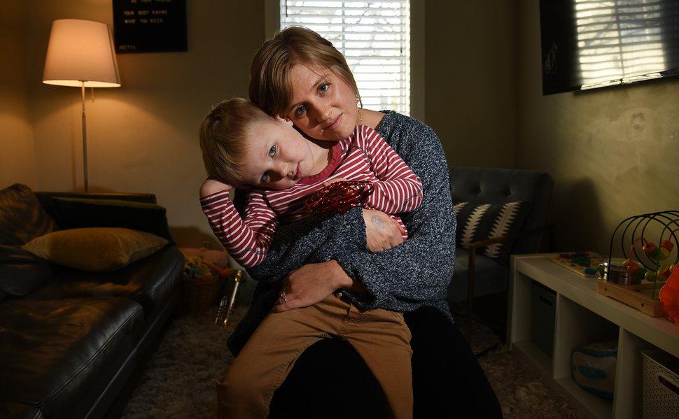 (Francisco Kjolseth   The Salt Lake Tribune) Nile Checketts embraces her son Wesley, 4, as she spends time with him while her 18-month-old daughter Valentine takes a nap at their Salt Lake City home on Monday, Dec. 9, 2019. Checketts had a full-time job doing office work, but quit after having her two children and started scooping ice cream at night part time because of high childcare costs and inflexibility at her job.