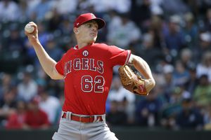 (Ted S. Warren | AP Photo) In this Sept. 10, 2017, file photo, Los Angeles Angels starting pitcher Parker Bridwell throws in the first inning of a baseball game against the Seattle Mariners in Seattle. Bridwell was claimed off waivers from the Angels by the New York Yankees on Monday, Nov. 26, 2018, who opened a roster spot by designating infielder Ronald Torreyes for assignment.