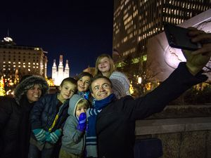 (Rick Egan | The Salt Lake Tribune)  Members of the Shea family from Salt Lake City, McKell, Mikey Sammy, Avielle, Betsy and Scott, take a selfie overlooking the Christmas lights on Temple Square, Friday, Nov. 27, 2020.
