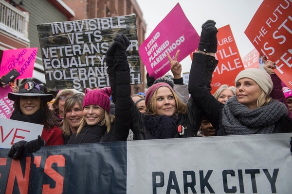 Actresses Chelsea Handler and Charlize Theron, right, participate in the