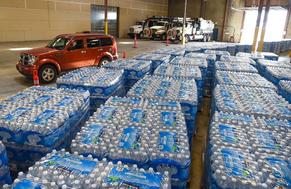 (Francisco Kjolseth | The Salt Lake Tribune) Cases of water are stored at the Sandy Operations Center at 9150 South, 150 East on Sunday, Feb. 17, 2019 for residents to drive thru and pick up. The no drink order now applies only to homes and businesses between 1700 East and 2000 East and 10600 South and 11400 South, the city announced Sunday. The city says the problem started about Feb. 6, when a fluoride pump malfunctioned because of a power outage. It flooded the water system with fluoride and that also led to high levels of lead and copper, enough that it made some people sick.