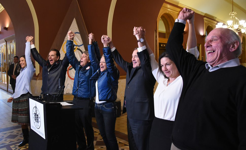 (Francisco Kjolseth | Tribune file photo) Salt Lake City officials celebrate after getting the news that U.S. Olympics Committee chose Salt Lake City over Denver to bid for a future Winter Olympics, possibly 2030, as they gather at City Hall on Friday, Dec. 14, 2018 to announce the decision. Raising their arms in celebration are councilman Erin Mendenhall, former Salt Lake Organizing Committee chief operating officer Fraser Bullock, Utah Sports Commission CEO Jeff Robbins, Mayor Jackie Biskupski, Gov. Gary Herbert, speed skater Catherine Raney Norman and councilman Jim Bradley, from left.