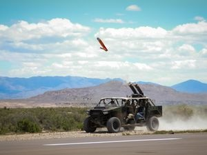 (Courtesy of the U.S. Army) An Army ATV, known as a DAGOR, fires a small drone from a pneumatic tube during EDGE21 training exercises at Utah's Dugway Proving Ground, held May 3 to May 14, 2021. The drone, used primarily for surveillance, can assist squads in the field.