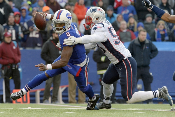 Buffalo Bills quarterback Tyrod Taylor (5) is sacked by New England Patriots outside linebacker Kyle Van Noy (53) during the second half of an NFL football game, Sunday, Dec. 3, 2017, in Orchard Park, N.Y. (AP Photo/Adrian Kraus)