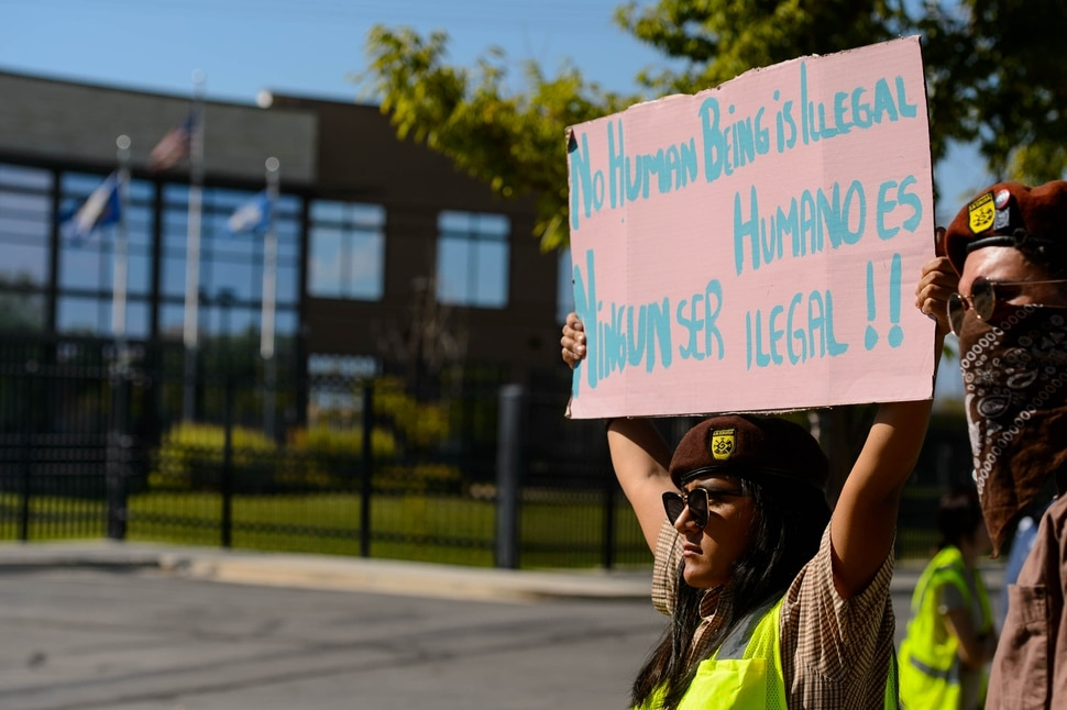 (Trent Nelson | The Salt Lake Tribune) An activist holds a sign during a rally in front of the Immigration and Customs Enforcement (ICE) office in West Valley City in support of Cecilia Figueroa on Friday Aug. 30, 2019.