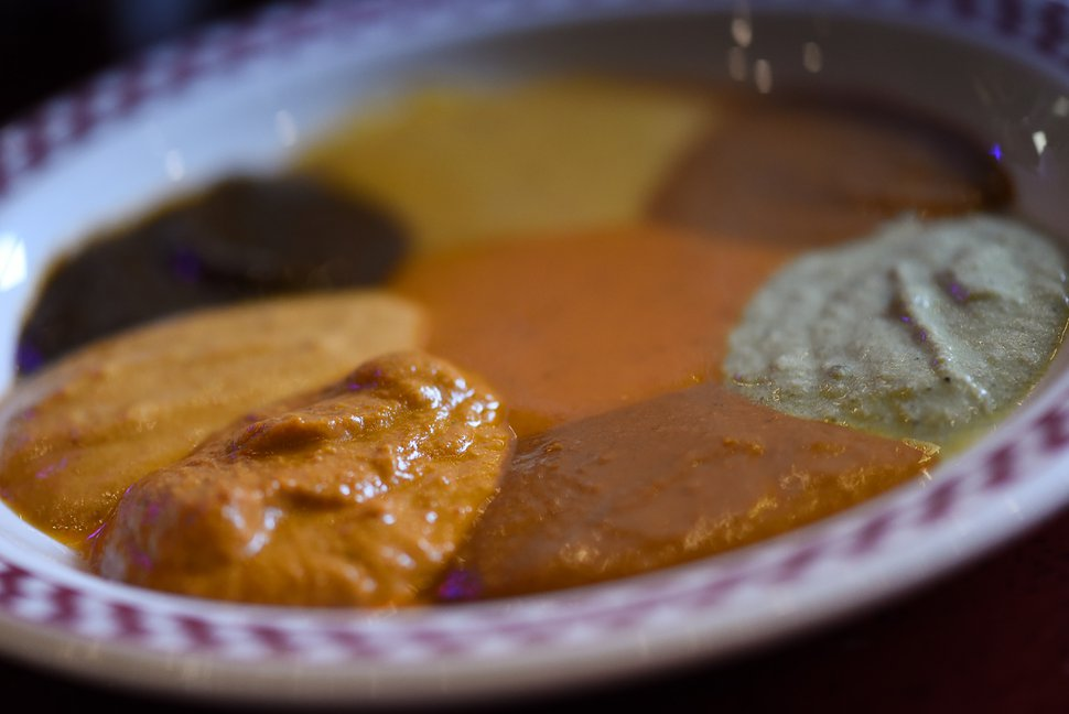 Francisco Kjolseth | The Salt Lake Tribune A sample plate of multiple types of mole at Red Iguana 2 give customers a chance to make a more informed decision before they order. Unlike many restaurants where a single chef is calling all the shots, Red Iguana has a kitchen manager, Matthew Hewitt, and a team of 8 lead cooks that have mastered the sauces and other recipes.