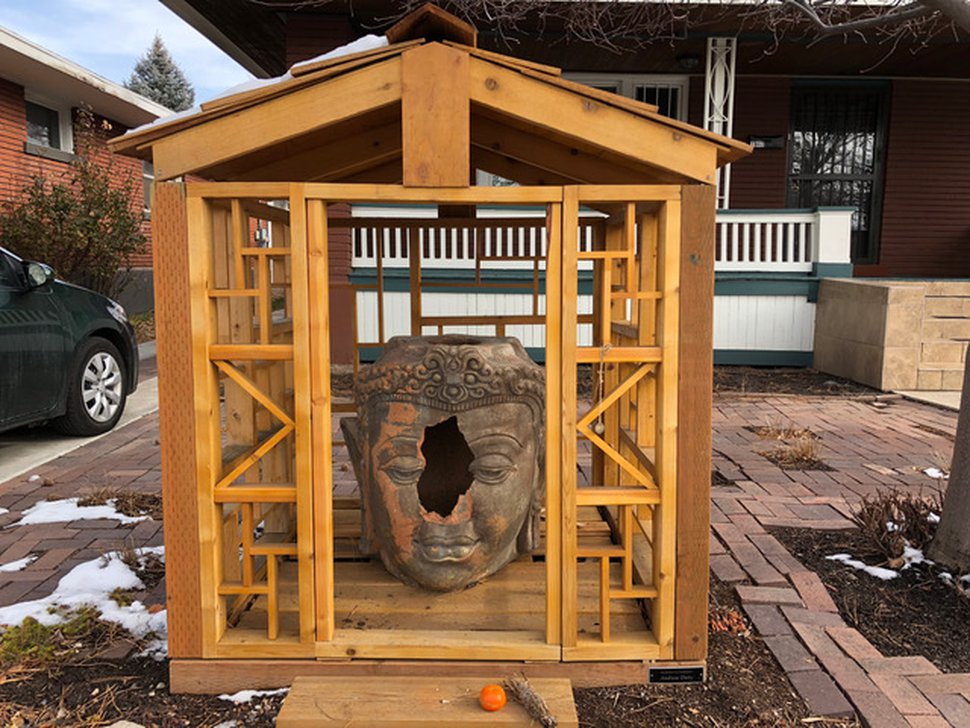 """(Photo courtesy Ben Dieterle) A vandal threw a large rock through this $3,000 terra cotta Buddha head early Wednesday at the popular """"Buddha on 9th"""" shrine in Salt Lake City. The owner is raising donations to repair or replace the artwork."""