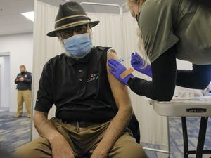 (Leah Hogsten | The Salt Lake Tribune) Siraj Ahmed, 67, receives his first free Moderna vaccination on Thursday from Salt Lake County Health Department nurse apprentice Bailey Weems. Over 120 people were scheduled to get their first shots of both the Moderna and Pfizer vaccines at the Utah Islamic Center in West Jordan, Mar. 18, 2021.