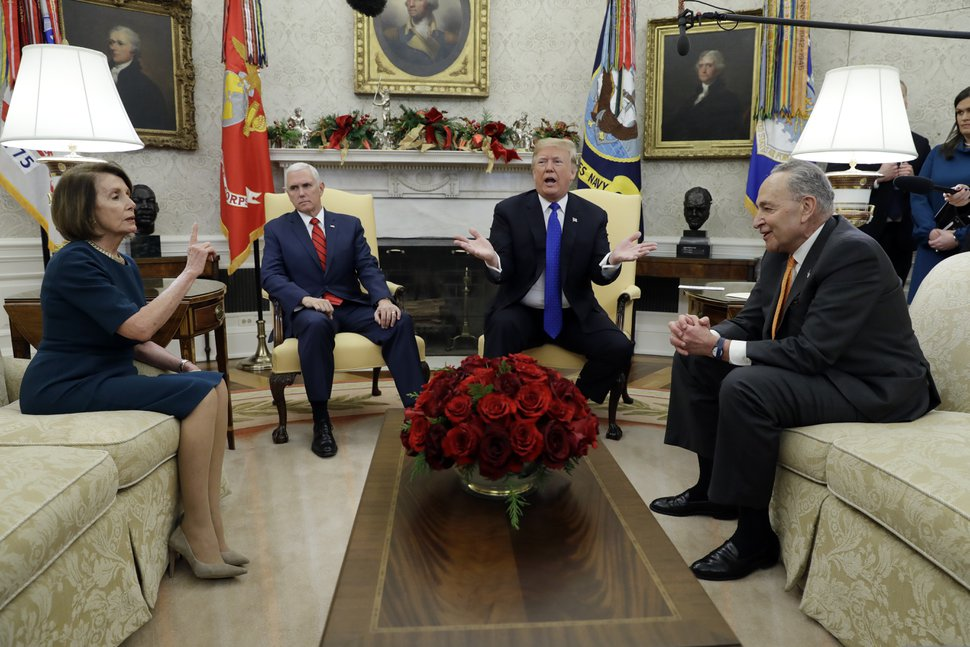 In this Dec. 11, 2018, photo, President Donald Trump and Vice President Mike Pence meet with Senate Minority Leader Chuck Schumer, D-N.Y., and House Minority Leader Nancy Pelosi, D-Calif., in the Oval Office of the White House in Washington. Congress is racing to avoid a partial government shutdown over President Donald Trump's border. But you wouldn't know it by the schedule. Lawmakers are away until next week. The ball is in Trump's court, both sides say. (AP Photo/Evan Vucci)