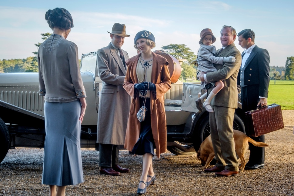This image released by Focus features shows Elizabeth McGovern, from left, Harry Hadden-Paton, Laura Carmichael, Hugh Bonneville and Michael Fox, right, in a scene from Downton Abbey. The highly-anticipated film continuation of the Masterpiece series that wowed audiences for six seasons, will be released Sept. 13, 2019, in the United Kingdom and on Sept. 20 in the United States. (Jaap Buitendijk/Focus Features via AP)