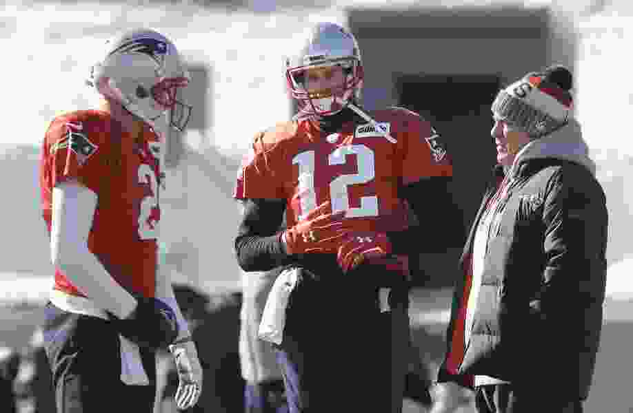 All eyes on Brady as he misses practice with hand injury