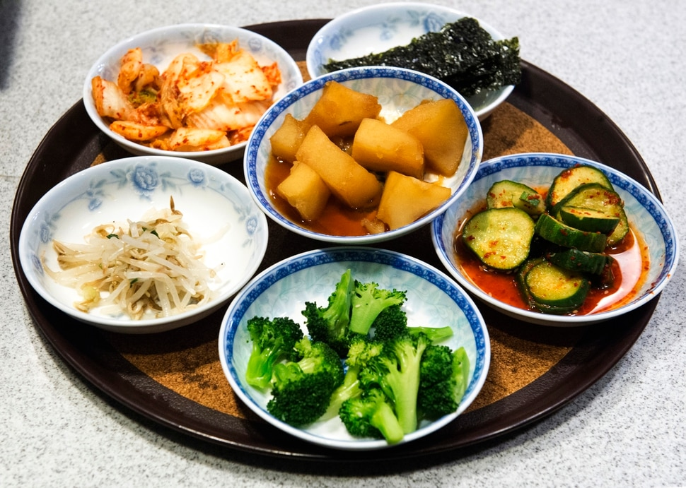 (Rick Egan | The Salt Lake Tribune) Banchan, or small side dishes, include seaweed, marinated cucumbers, steamed broccoli, sprouts, kimchi, and roasted potatoes, at Myung Ga Korean restaurant, in West Valley City.