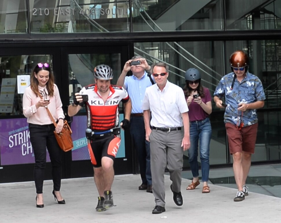 (Rick Egan | The Salt Lake Tribune) Salt Lake Tribune reporters and editors leave Library Square at the start of a race against colleagues in a transportation race from Library Square to the Tribune building at the Gateway on Thursday, Aug. 2, 2018.