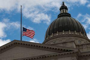 (Francisco Kjolseth  | The Salt Lake Tribune) The flag flies at half-staff on Tuesday, Feb. 23, 2021 at the Utah Capitol.