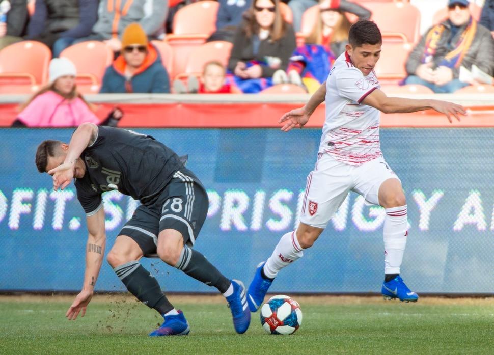 (Rick Egan | The Salt Lake Tribune) Real Salt Lake forward Jefferson Savarino (7) goes for the ball along with Vancouver Whitecaps defender Jake Nerwinski (28) in MLS soccer action at Rio Tinto Stadium in Sandy, Saturday, March 9, 2019.