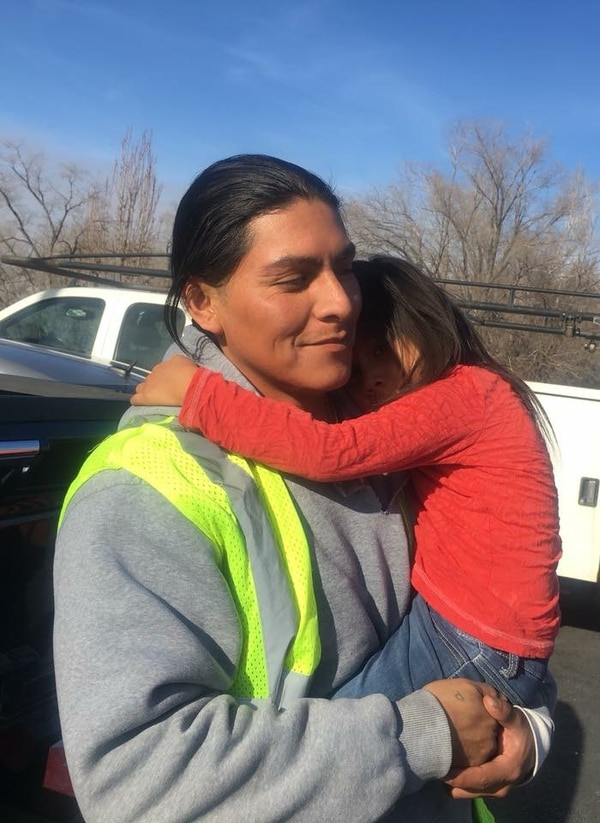 (Photo courtesy of Julia Peterson) In a recent photo, Delorean Pikyavit holds one of his children during a visit. Pikyavit was shot and killed by Salt Lake City police Wednesday, April 18, 2018.