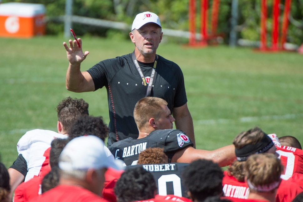 (Rick Egan | The Salt Lake Tribune) Coach Kyle Whittingham talks to the team during practice. Whittingham is entering his 14th year as Utah head coach, Wednesday, Aug. 15, 2018.
